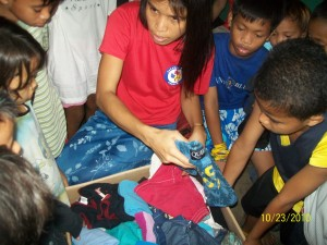 Poor children recieve used clothes